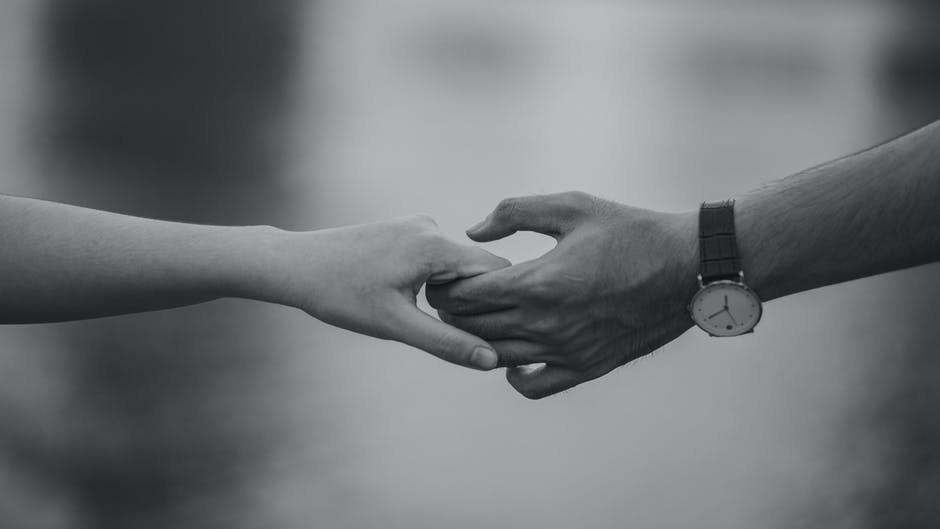 A close up of holding hands
